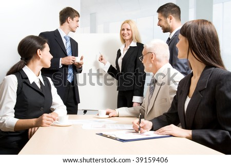 Group of business people discussing  the results of their work