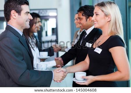 group of business people handshaking during seminar