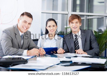 Group of business people happy smile work together, businesspeople working at meeting with colleague team sitting at desk in office
