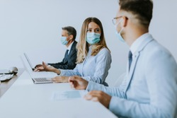 Group of business people have a meeting and working in the office and wear protective facial masks as protection from corona virus