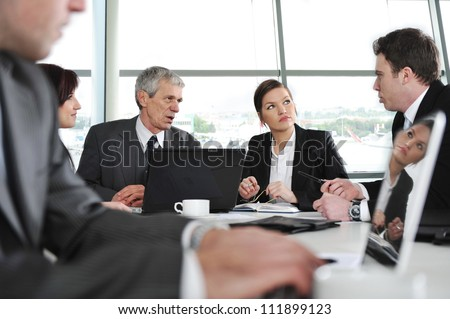 Group of business people having discussion in office