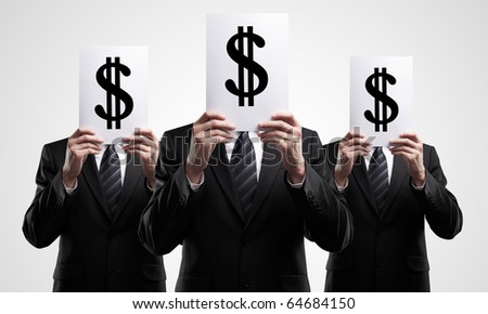 group of business people holding a dollar mark - stock photo