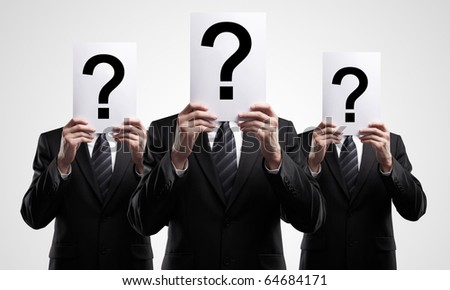 group of business people holding a question mark