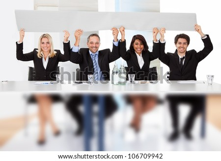 Group of business people holding empty placard