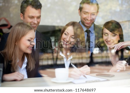 Group of business people in coffee shop.