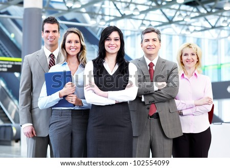 Group of business people in the modern urban hall.