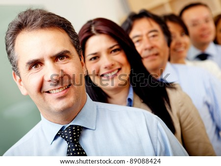 Group of business people lead by a man at the office