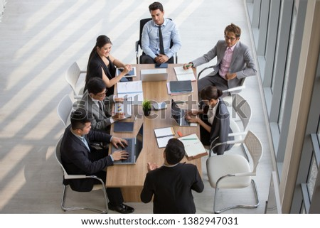 Group of business People Meeting Conference in office . marketing team Brainstorming Teamwork together at workspace.Discussion Corporate coworkers discussing Financial . multi-ethnic. High angle view  #1382947031