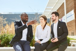 Group of business people of a business start-up at a meeting outdoors