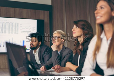 Group of business people on a meeting in a conference room. Focus on the woman on the left
