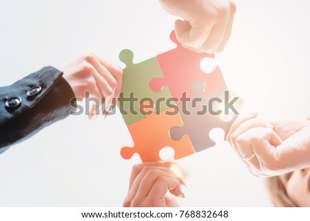 group of business people puting ...