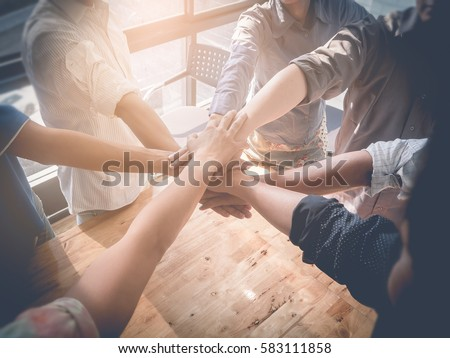 Group of Business people putting their hands working together on wooden background in office. group support teamwork cooperation concept. #583111858