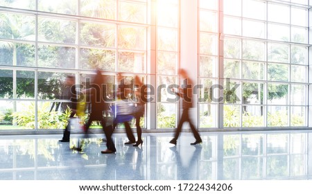 Group of business people rushing in the lobby. motion blur