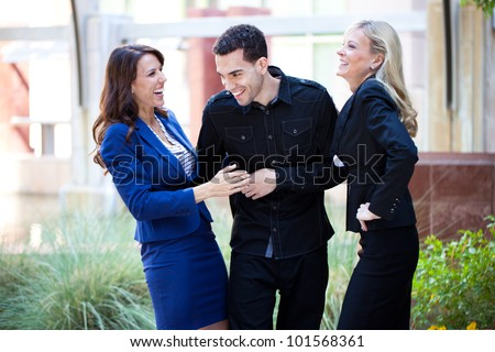 Group of Business People Smiling and laughing outside the office