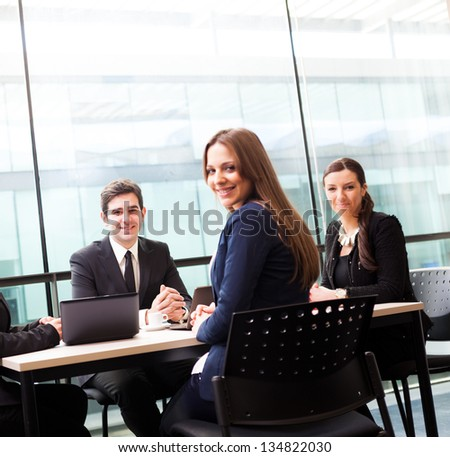 Group of business people smiling at the office, focus on man