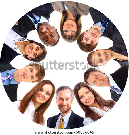 Group of business people standing in huddle, smiling, low angle view