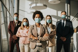 Group of business people standing in the office and wear mask for protect prevent infection by corona virus