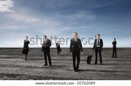 Group of business people standing on a field