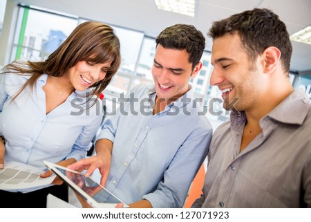 Group of business people using a tablet computer