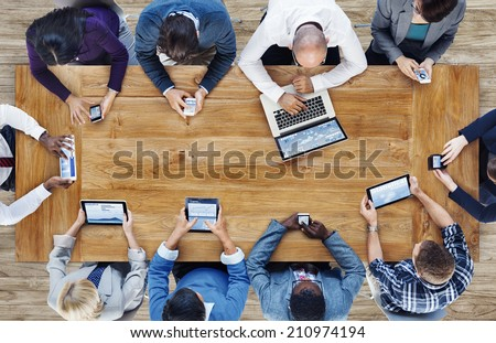 Group of Business People Using Digital Devices - Shutterstock ID 210974194