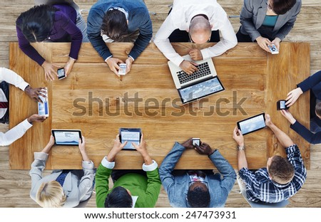 Group of Business People Using Digital Devices - Shutterstock ID 247473931