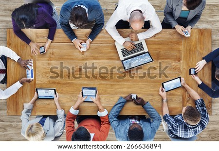 Group of Business People Using Digital Devices - Shutterstock ID 266636894