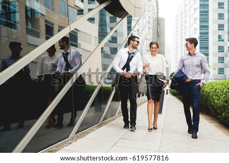 Group of business people walking talking.
