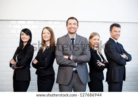 Group of business people with businessman leader on foreground