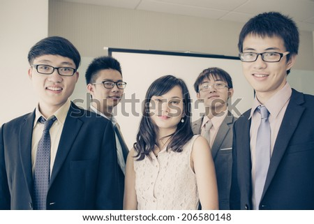 Group of business people with businessman leader on foreground.Asian #206580148