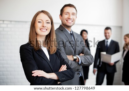 Group of business people  with female leader in foreground