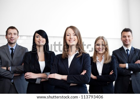 Group of business people with female leader on foreground