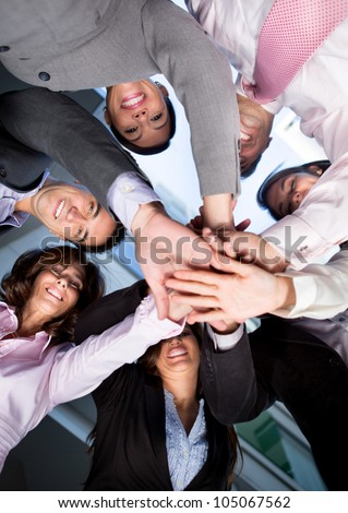 Group of business people with hands together - teamwork concepts