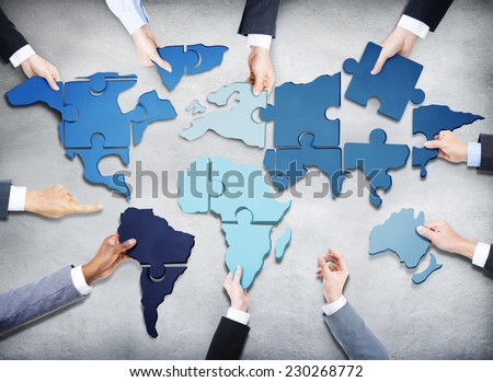 Group of Business People with Jigsaw Puzzle Forming in World Map #230268772