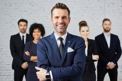 Group of business people with leader at front