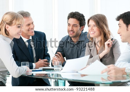 Group of business people working and discussing together at office