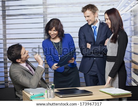 Group of business people working as a team at the office