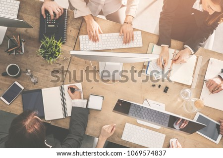 Group of business people working in office #1069574837