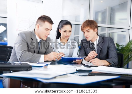 Group of business people working on plan in a meeting at office desk work together, businesspeople colleague team sitting at desk in office discussing report document