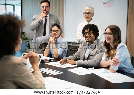 Group of business people working together, brainstorming in office