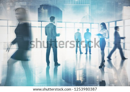 Group of business people working together in empty office lobby. Double exposure of modern cityscape. Corporate lifestyle concept. Toned image film effect blurred