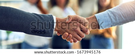 Group of business workers standing together shaking hands at the office Foto stock ©
