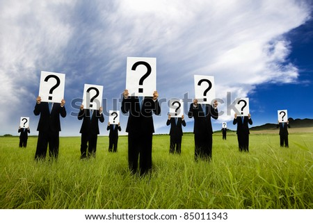 group of businessman in black suit and holding question mark symbol