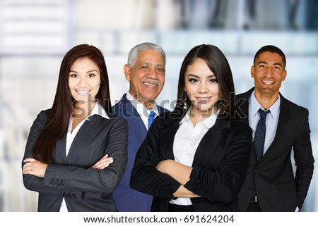 Group of businessmen and women working together #691624204
