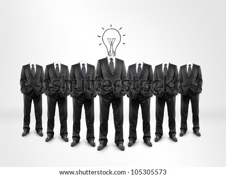 group of businessmen drawing lightbulb in  head