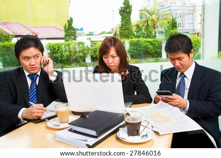 Group of businesspeople busy by themselves - stock photo