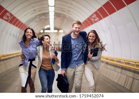 Group of businesspeople casually going to the subway train station Сток-фото ©