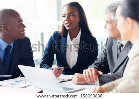 group of businesspeople having a meeting in modern office