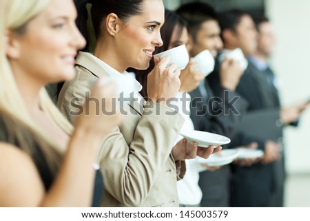 group of businesspeople having coffee during conference coffee break