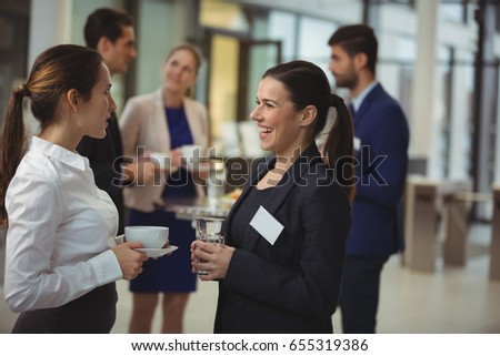Group of businesspeople interacting with each other in the lobby at office #655319386
