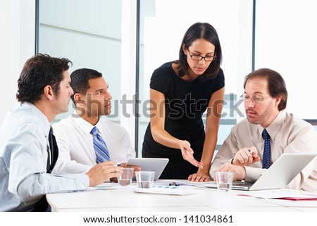 Group Of Businesspeople Meeting In Office